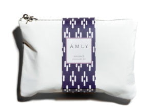 AMLY Radiance Discovery Skincare Kit - white purse on white background