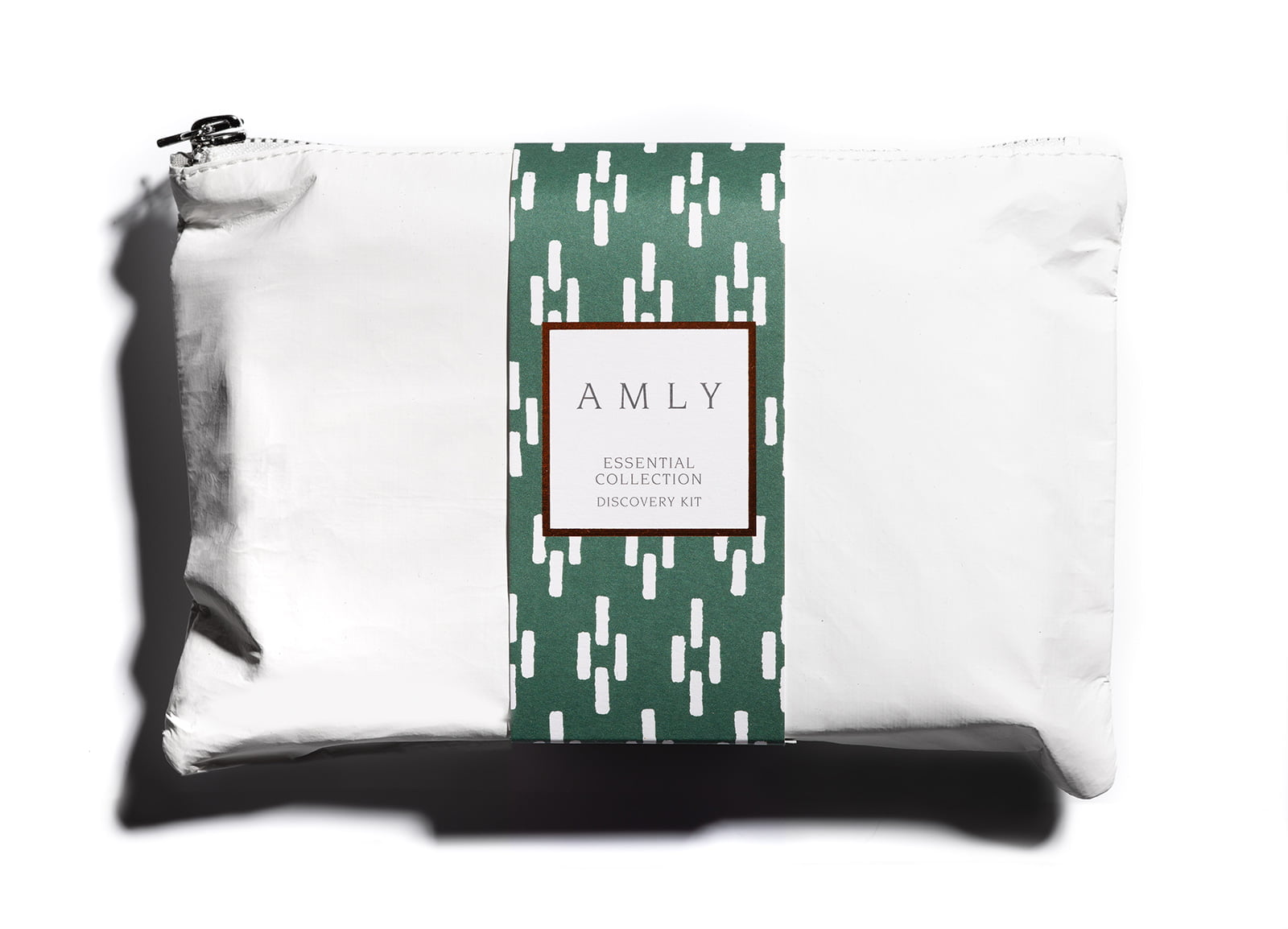 AMLY Skincare pouch with the 'essential collection' discovery set of AMLY mini botanical skincare bottles 2