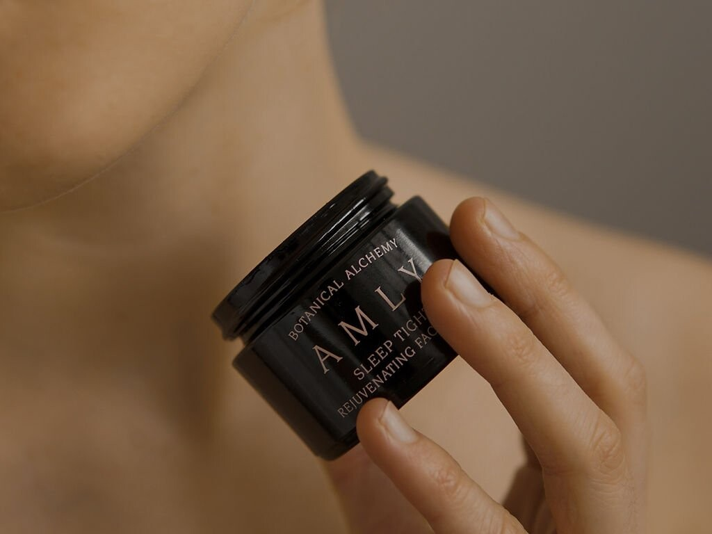 AMLY Botanical Skincare Sleep Tight face balm 100ml in hand without lid- part of the evening prescription routine