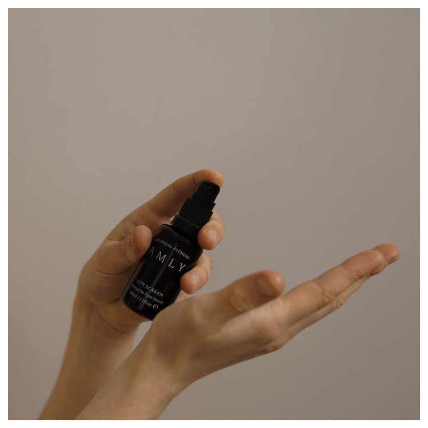 AMLY Botanicals City Screen protective Face Serum - being pumped onto hand